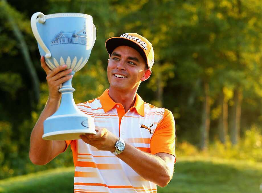 NORTON, MA - SEPTEMBER 07:  Rickie Fowler celebrates with the winners trophy after the final round of the Deutsche Bank Championship on September 7, 2015 in Norton, Massachusetts.  (Photo by Maddie Meyer/Getty Images) Photo: Maddie Meyer, Getty Images