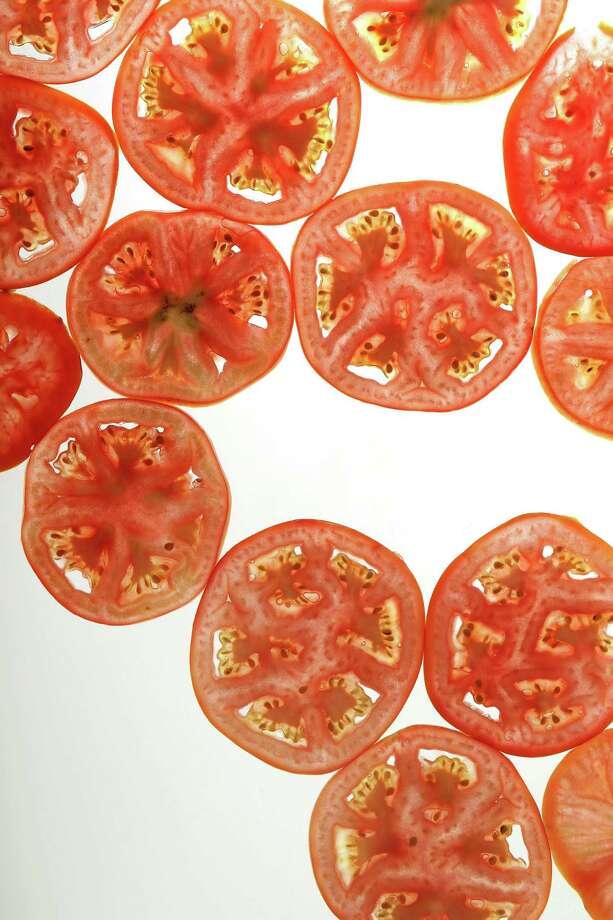 Tomato slices. (Chris Lee/St. Louis Post-Dispatch/TNS) Photo: Chris Lee, MBR / TNS / St. Louis Post-Dispatch