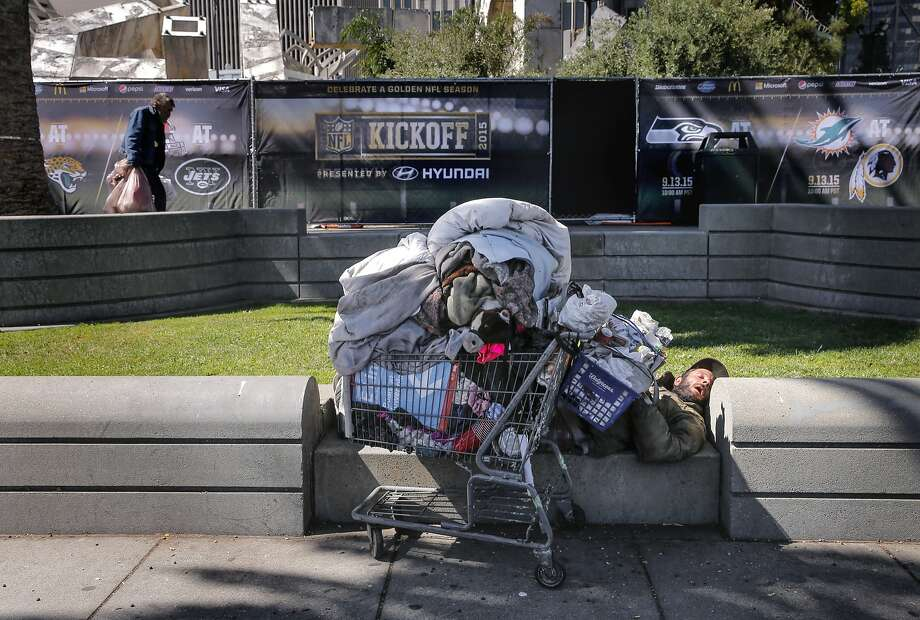 Mark Taos, who is homeless, was seen sleeping on the eastern edge of Justin Herman plaza along the Embarcadero, as the NFL and the Bay Area Super Bowl Committee officially kick off the football season with an event nearby on Tues. September 9, 2015,  in San Francisco, Calif. San Francisco will host Superbowl 50 in Santa Clara at the end of the NFL season. Photo: Michael Macor, The Chronicle