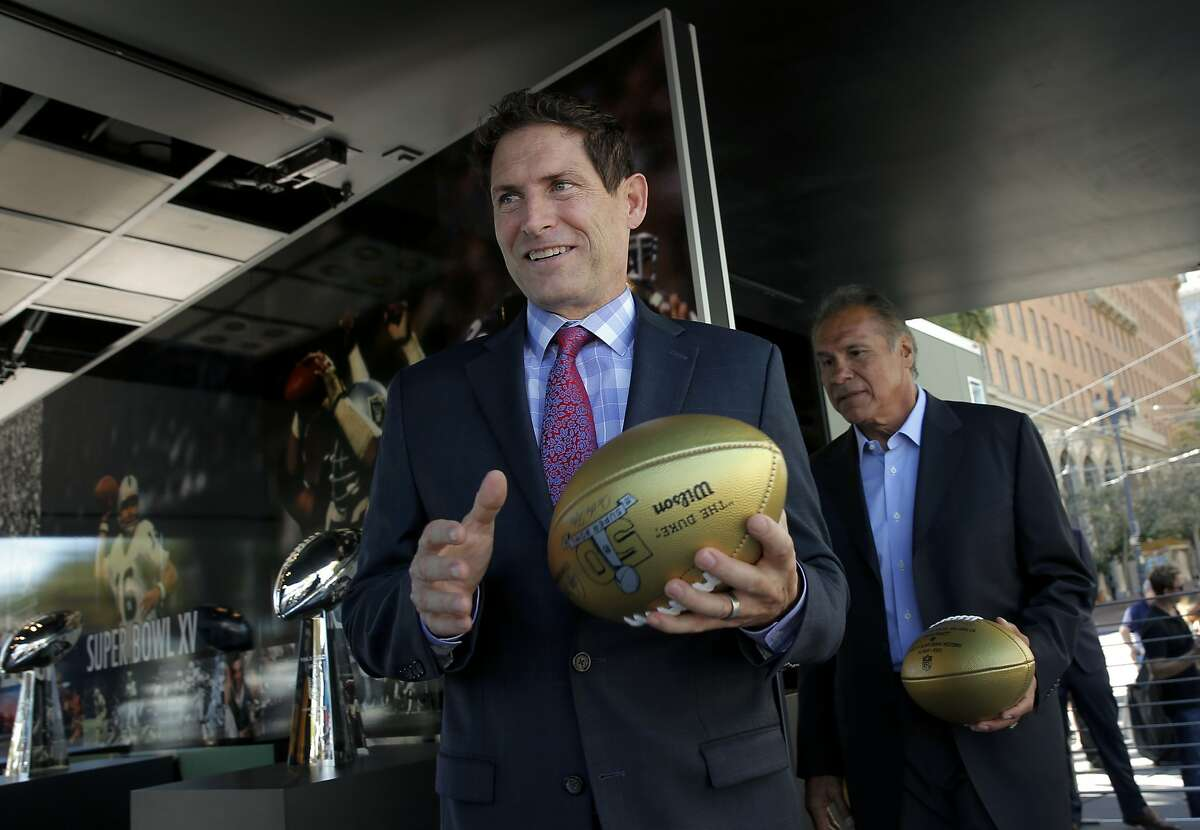 San Francisco 49er great Steve Young, (left) and Oakland Raider great Jim Plunkett were on hand, as the NFL and the Bay Area Super Bowl Committee officially kicked off the football season with an event to unveil a mobile exhibit designed to celebrate the history of the Bay Area champion Oakland Raiders and San Francisco 49ers showcasing the 8 Super Bowl trophies the teams have won on Tues. September 9, 2015, in San Francisco, Calif. San Francisco will host Super Bowl 50 in Santa Clara at the end of the NFL season.