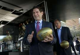 San Francisco 49er great Steve Young, (left) and Oakland Raider great Jim Plunkett were on hand, as the NFL and the Bay Area Super Bowl Committee officially kicked off the football season with an event to unveil a mobile exhibit designed to celebrate the history of the Bay Area champion Oakland Raiders and San Francisco 49ers showcasing the 8 Super Bowl trophies the teams have won, currently at Justin Herman Plaza  on Tues. September 9, 2015, in San Francisco, Calif. San Francisco will host Super Bowl 50 in Santa Clara at the end of the NFL season.
