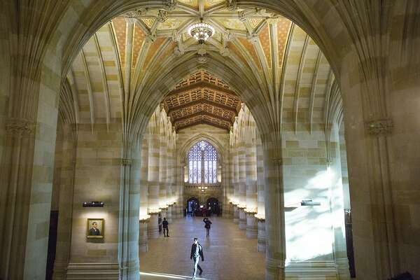 The grand nave of the Sterling Memorial Library, at Yale University in New Haven, Conn., Nov. 18, 2014. Once reviled in some quarters as movie-set medieval and too overtly Christian in design, Sterling is now such an important symbol to Yale that an alumnus donated $20 million to restore, clean, modernize and reimagine the nave. (Christopher Capozziello/The New York Times)