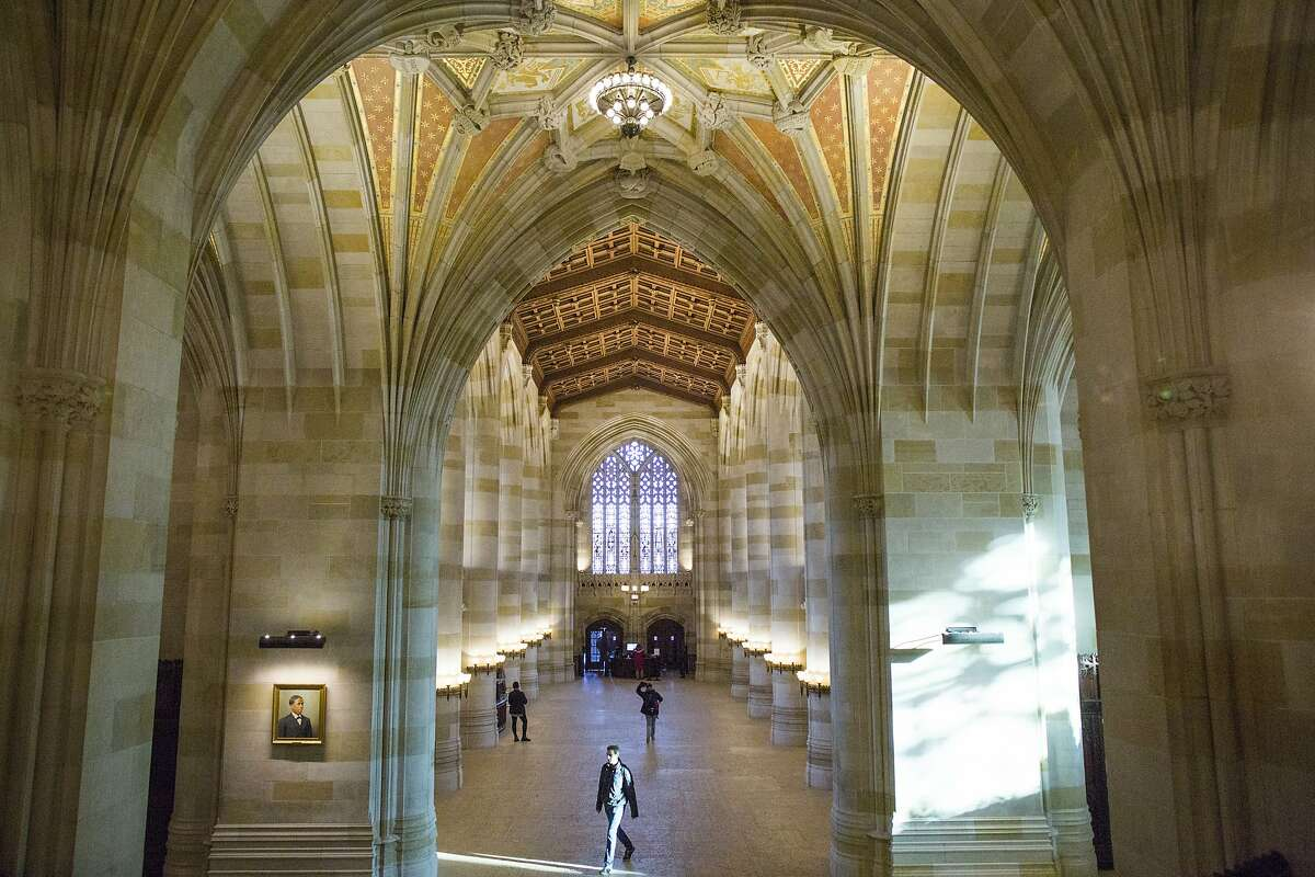 Click to learn the oldest colleges in each state, according to Business Insider. Pictured: Yale University library