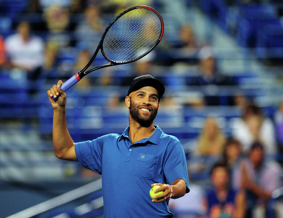 James Blake waves during an exhibition match against Andy Roddick at the Connecticut Open on Aug. 21.