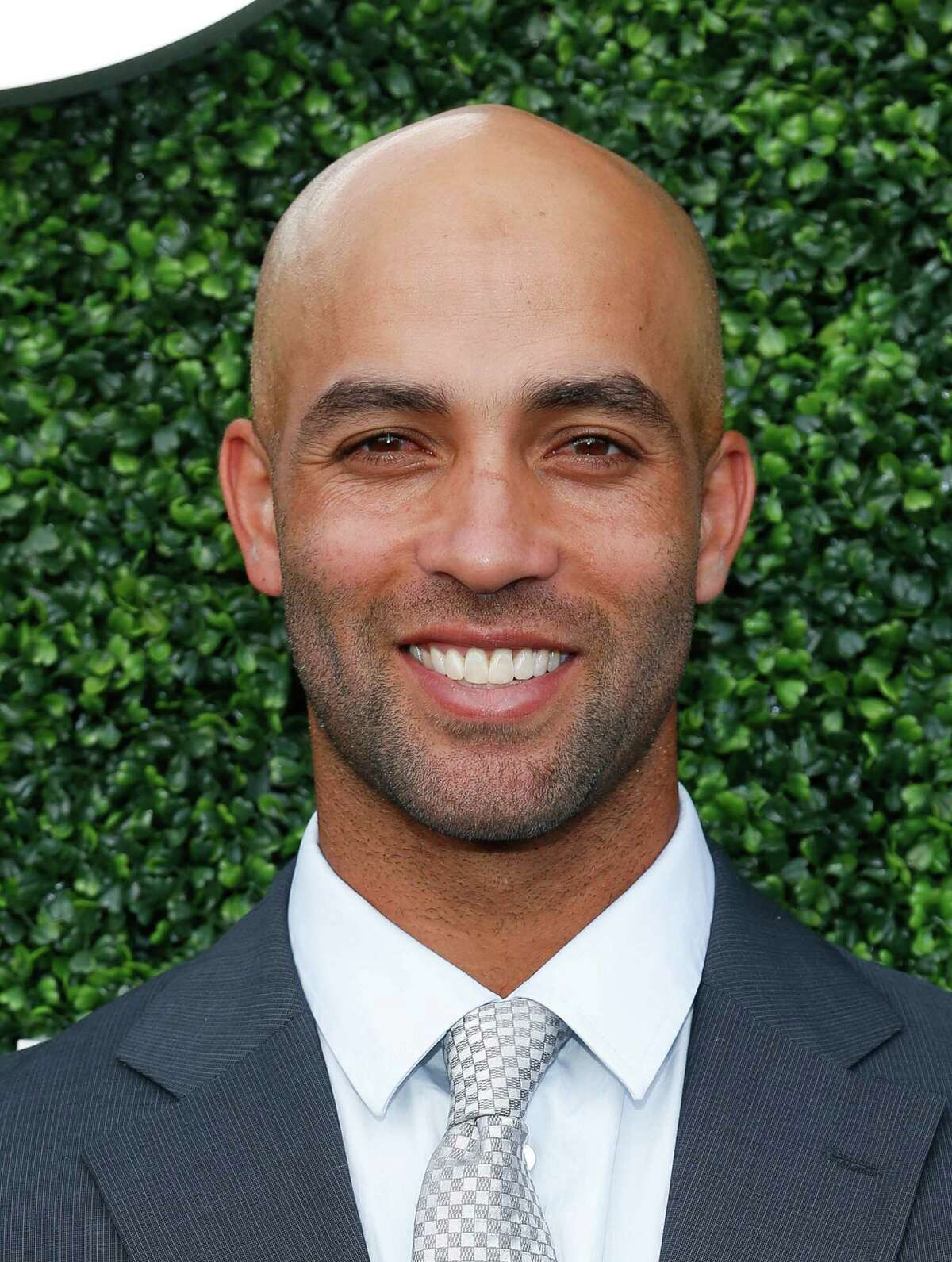 Tennis star James Blake was body slammed and cuffed outside a midtown hotel by a New York police officer who mistook him for a suspect.