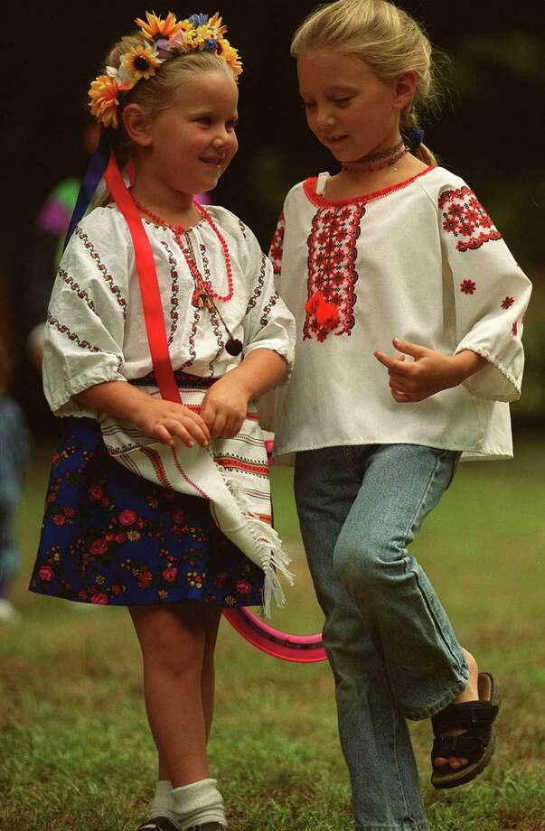 Left, Shannon Paproski,6, and her sister, Stephanie, 9, both of Newtown practice some dancing steps yesterday at the Ukrainian Festival held at their grandmother's, Olga Paproski, in Newtown. Photo: File Photo\Wendy Carlson / File Photo\Wendy Carlson / The News-Times File Photo
