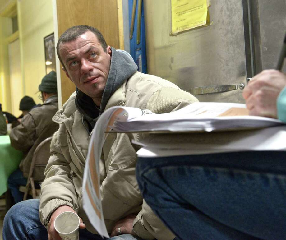 Mike Mangogna fills out a survey in February during the annual point-in-time homeless count in Danbury. Photo: H John Voorhees III / Hearst Connecticut Media / The News-Times