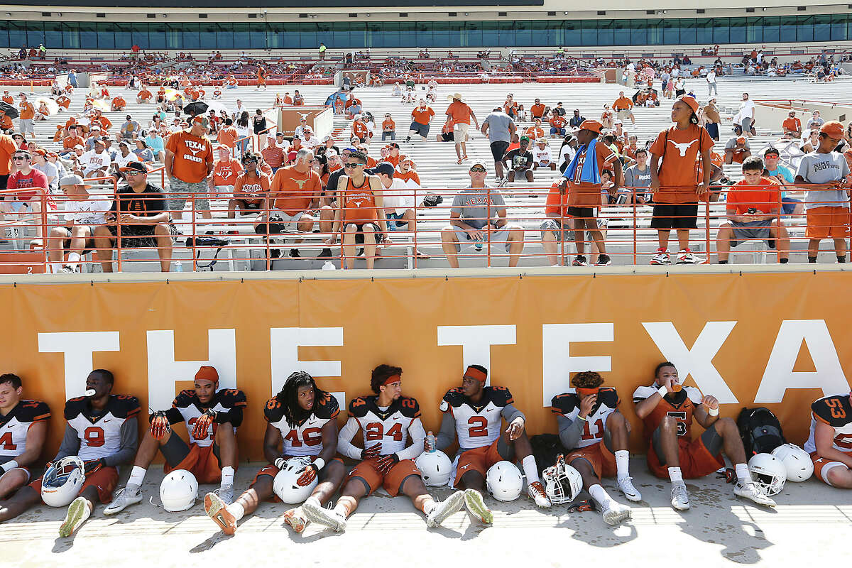Texas players enjoy a water break during an open practice and fan appreciation day at Darrell K. Royal Memorial Stadium Sunday, Aug. 9, 2015.