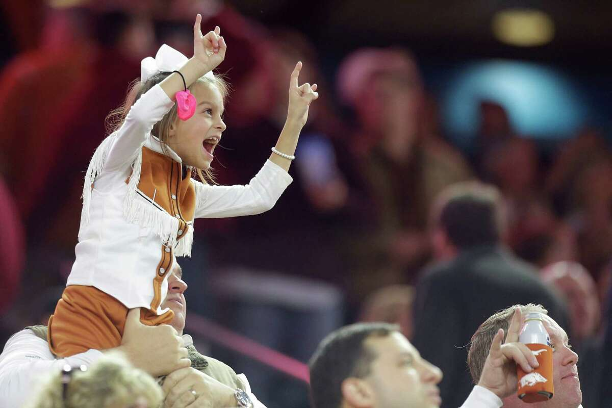 A Texas fan cheers during the second quarter of theTexas Bowl at NRG Stadium on Monday, Dec. 29, 2014, in Houston.