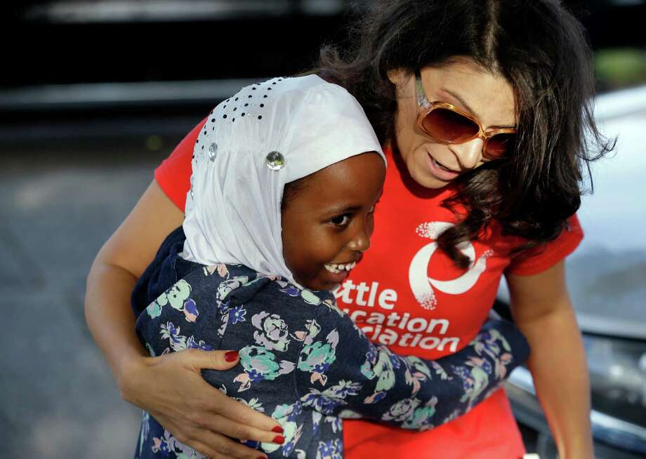 First-grade student Halima Said, 6, meets her teacher, Amber Simonton, for the first time on the picket line where Simonton joined other teachers Wednesday morning in Seattle. Photo: Elaine Thompson, STF / AP