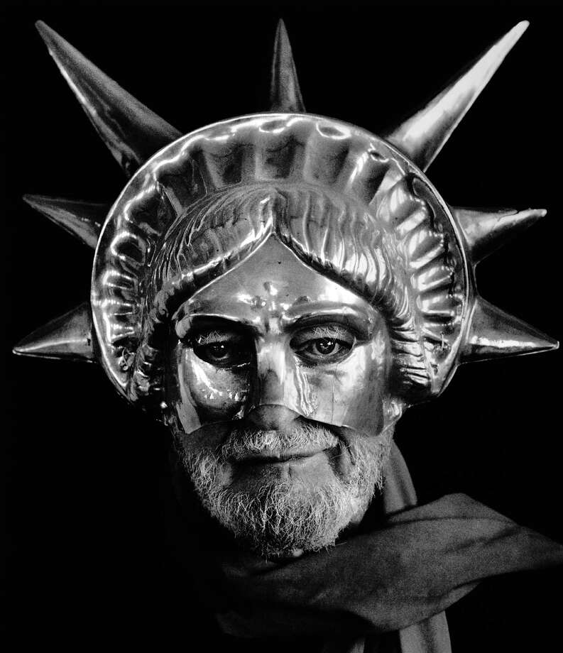 Lawrence Ferlinghetti wears a Statue of Liberty mask in San Francisco in 1982. Photo: Chris Felver / Getty Images / Archive Photos