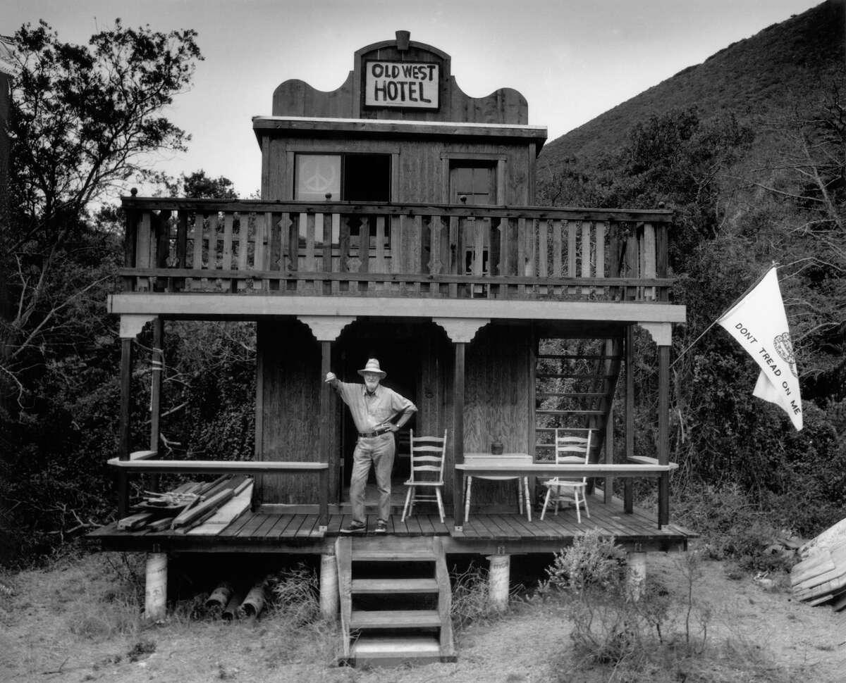 """Lawrence Ferlinghetti outside the """"Old West Hotel,"""" better known as Ferlinghetti's cabin, in Bixby Canyon, in 1997."""