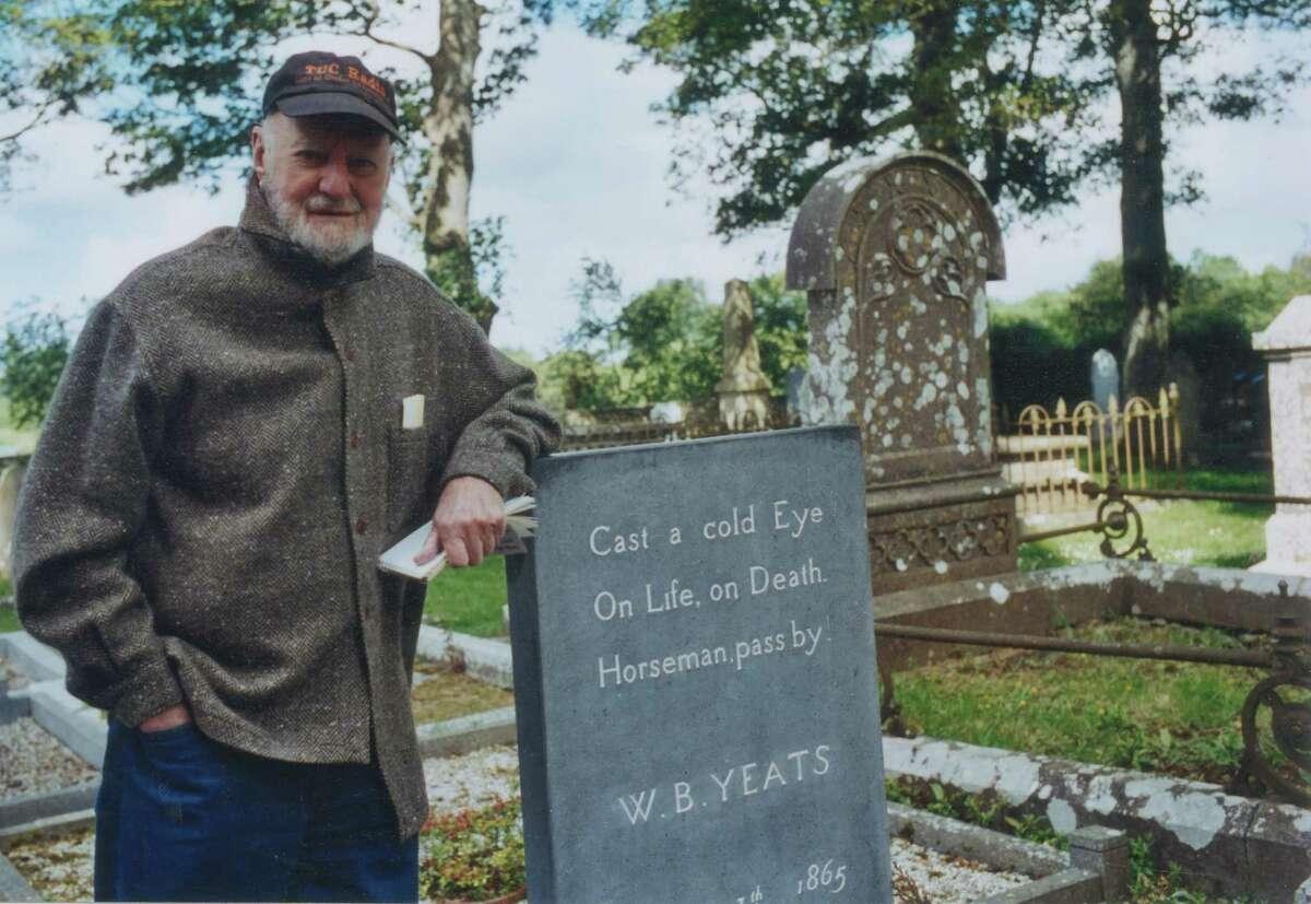 Lawrence Ferlinghetti stands beside W.B. Yeats' grave in Drumcliff, Ireland, in 2000.