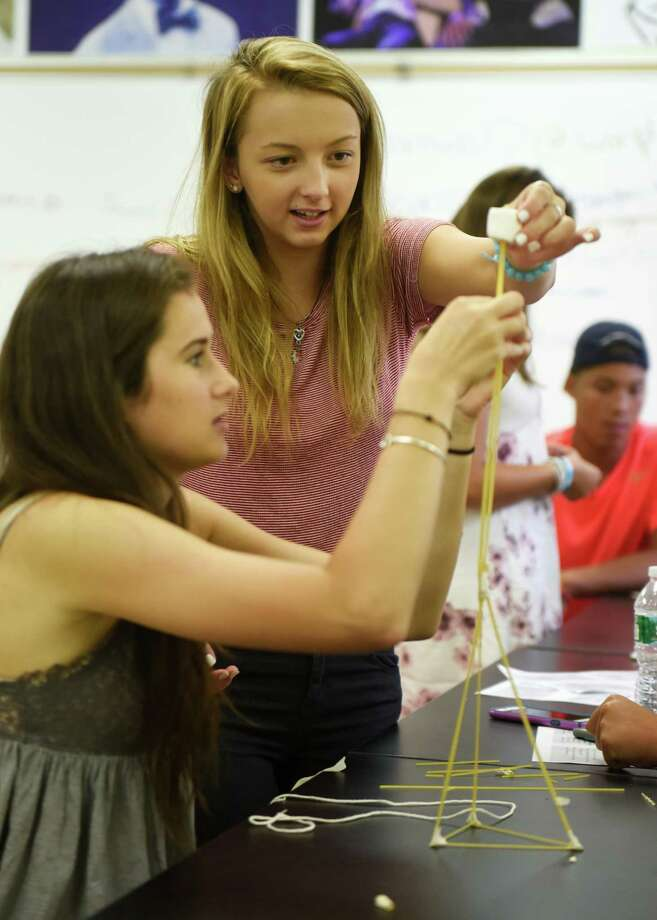 Sophomores Sofia Dodaro, left, and Fjolla Gashi attempt to build a tower out of spaghetti, tape and a single marshmallow during their Innovation Lab class at Greenwich High School in Greenwich, Conn. Thursday, Sept. 3, 2015. Photo: Tyler Sizemore / Hearst Connecticut Media / Greenwich Time