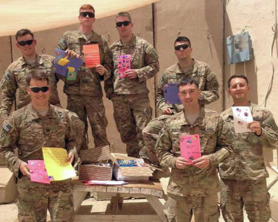 Members of the 3rd Brigade, 82nd Airborne Division stationed in Iraq were the recipients of 39 boxes of items collected and sent overseas by the Faith Formation program children at St. Catherine of Siena Church in Riverside. Along with the care packages, the children made cards and wrote letters to the soldiers. They recently recieved this photo and letters from the soldiers expressing their thanks. Photo: Contributed / Contributed Photo / Greenwich Time Contributed