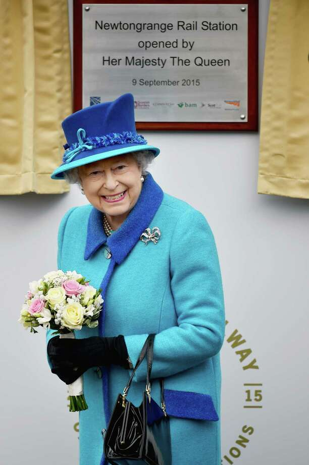 NEWTONGRANGE, SCOTLAND - SEPTEMBER 09:  Queen Elizabeth II opens Newtongrange Station after arriving on the steam locomotive the 'Union of South Africa' on September 9, 2015 in Newtongrange , Scotland.Today, Her Majesty Queen Elizabeth II becomes the longest reigning monarch in British history overtaking her great-great grandmother Queen Victorias record by one day. The Queen has reigned for a total of 63 years and 217 days. Accompanied by her husband The Duke of Edinburgh, she has today opened the new Scottish Borders Railway.  (Photo by Jeff J Mitchell/Getty Images) *** BESTPIX *** Photo: Jeff J Mitchell, Staff / 2015 Getty Images