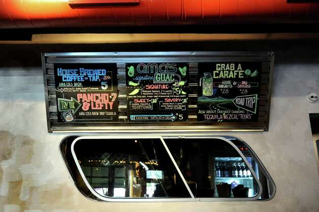 Bus window in the dining room on Friday, Sept. 4, 2015, at Ama Cocina in Albany, N.Y. (Cindy Schultz / Times Union) Photo: Cindy Schultz / 00033218A