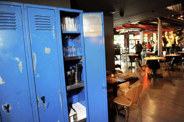 Vintage lockers store table settings in the dining room on Friday, Sept. 4, 2015, at Ama Cocina in Albany, N.Y. (Cindy Schultz / Times Union) Photo: Cindy Schultz / 00033218A