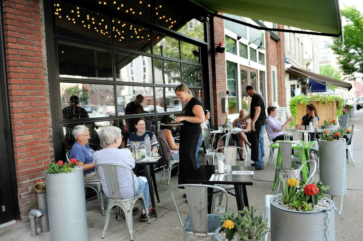 Sidewalk dining complete with garage doors that can open up on Friday, Sept. 4, 2015, at Ama Cocina in Albany, N.Y. (Cindy Schultz / Times Union)