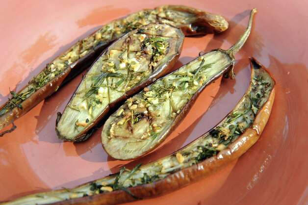 Grilled marinated Japanese eggplant with garlic and herbs on Saturday, Aug. 29, 2015, in Delmar, N.Y. (Cindy Schultz / Times Union) Photo: Cindy Schultz / 00033132A