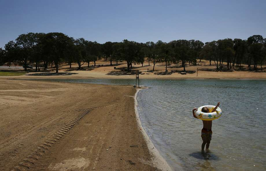 Anthony James Meleen, 3, struggles to get his arms through a float while playing in the swimming lagoon Aug. 19 at the Don Pedro Reservoirin La Grangeas it hovers at 32 percent ofcapacity. Photo: Leah Millis, The Chronicle