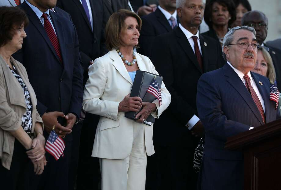 House Minority Leader Nancy Pelosi (center) listens as Rep. George Butterfield, D-N.C., speaks at a Washington rally that Pelosi hosted Tuesday in support of the Iran nuclear deal. Photo: Alex Wong, Getty Images