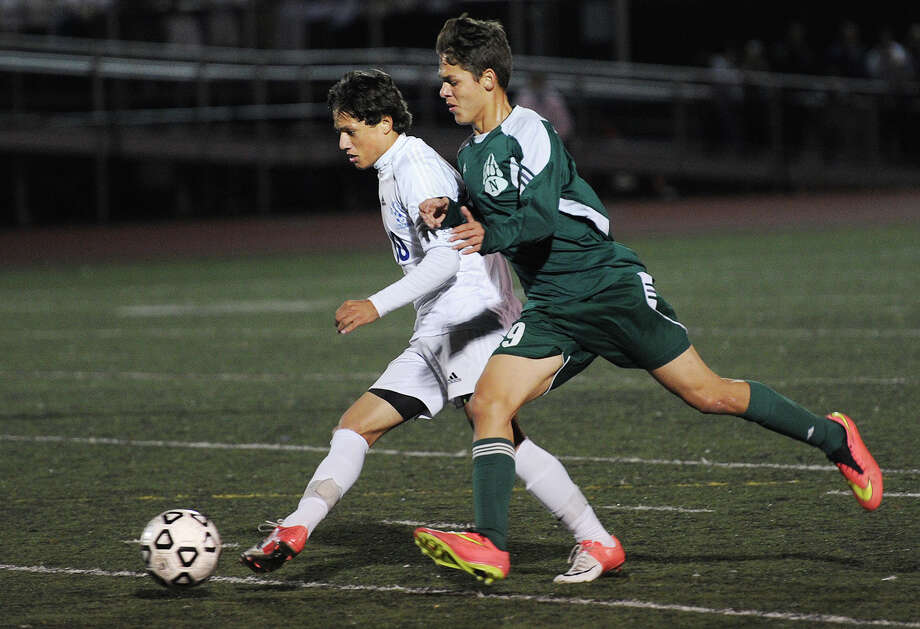 Ludlowe's Tulio Almeida plays the ball ahead of Norwalk defender Santiago Mesa during the FCIAC boys soccer semifinals at Ludlowe High School in Fairfield, Conn. on Monday, October 27, 2014. Photo: Brian A. Pounds / Brian A. Pounds / Connecticut Post