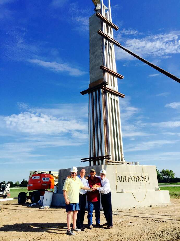Fort Bend County,  the Katy Rotary Club and Fund, and Veterans of Foreign Wars Post 9182 will dedicate and consecrate the Freedom Park Memorial Tower at 10 a.m. Sept. 11. From left are Katy Rotarian Ken Burton, Fort Bend County Commissioner Andy Meyers, monument builder Jeff Pantle and Katy Rotarian David Frishman. Photo: Courtesy David Frishman