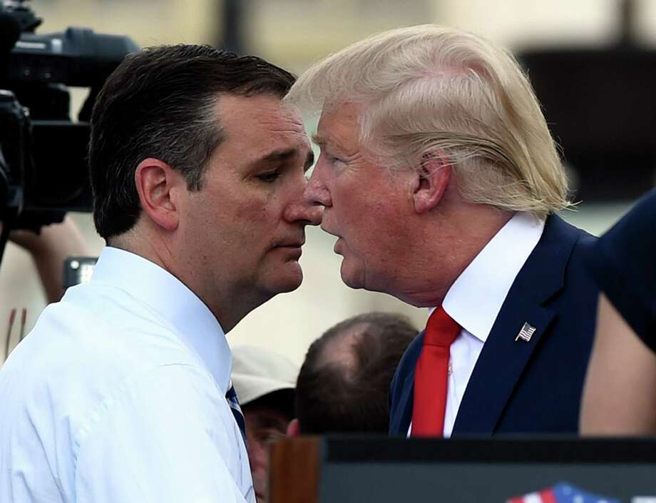 Republican Presidential candidate Donald Trump, right, speaks with fellow Republican presidential candidate Sen. Ted Cruz, R-Texas, during a rally opposing the Iran nuclear deal outside the Capitol in Washington, Wednesday, Sept. 9, 2015. (AP Photo/Susan Walsh) Photo: Susan Walsh, STF / Associated Press / AP