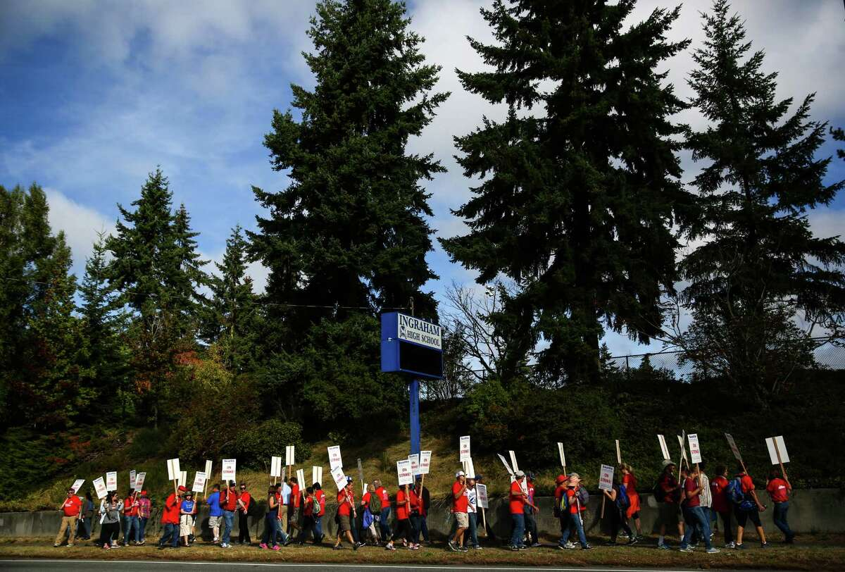 Educators march outside of Ingraham High School during day one of a strike by Seattle Public School teachers and staff members. Educators walked the picket lines on what was to be the first day of school. Photographed on Wednesday, September 9, 2015.