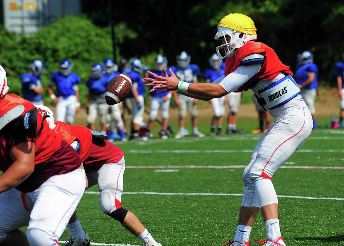 Fairfield Prep's Pat Conti receives the snap during scrimage action against Fairfield Ludlowe on Benson Field at Fairfield University in Fairfield, Conn. on Saturday Aug. 29, 2015.