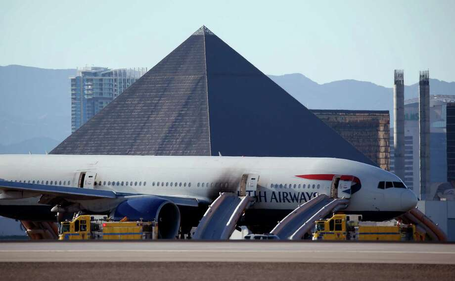 This British Airways jet caught fire at McCarren International Airport in Las Vegas. Despite warnings to flee without their carry-on bags, many passengers disobeyed the flight crew's instructions, officials said. Photo: John Locher, STF / AP