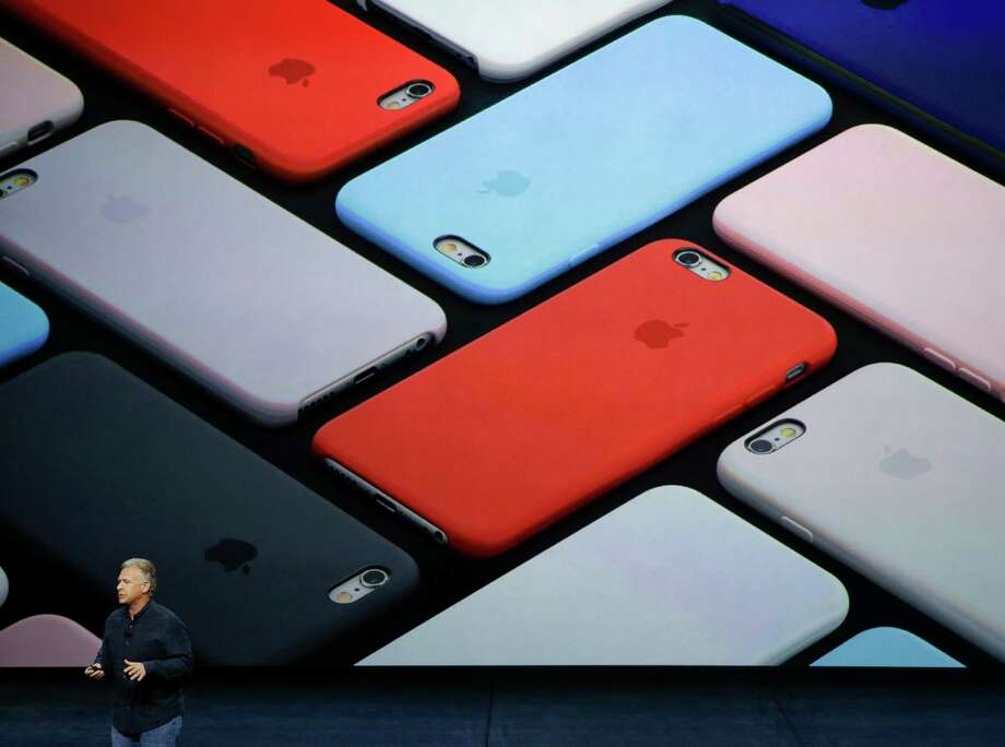 Phil Schiller, Apple's senior vice president of worldwide marketing, talks about the camera features of the new iPhone 6s and iPhone 6s Plus during the Apple event at the Bill Graham Civic Auditorium in San Francisco, Wednesday, Sept. 9, 2015. (AP Photo/Eric Risberg) ORG XMIT: FX146 Photo: Eric Risberg / AP