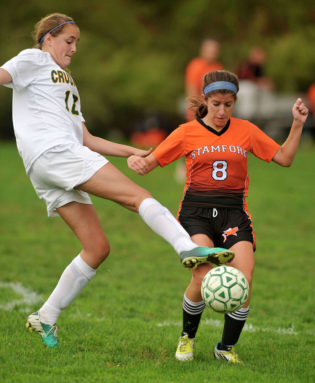 Trinity Catholic's Mary Conlon challenges Stamford's Mia Vitti for the ball during their soccer game at Trinity Catholic High School in Stamford, Conn., on Tuesday, Oct. 21, 2014. Stamford won, 5-0.