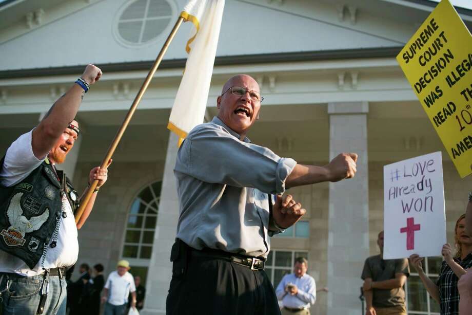 Randy Smith, a Baptist preacher, rallies opponents of same-sex marriage rights, outside the Rowan County Courthouse in Morehead, Ky., on Sept. 4. Photo: MADDIE MCGARVEY /New York Times / NYTNS