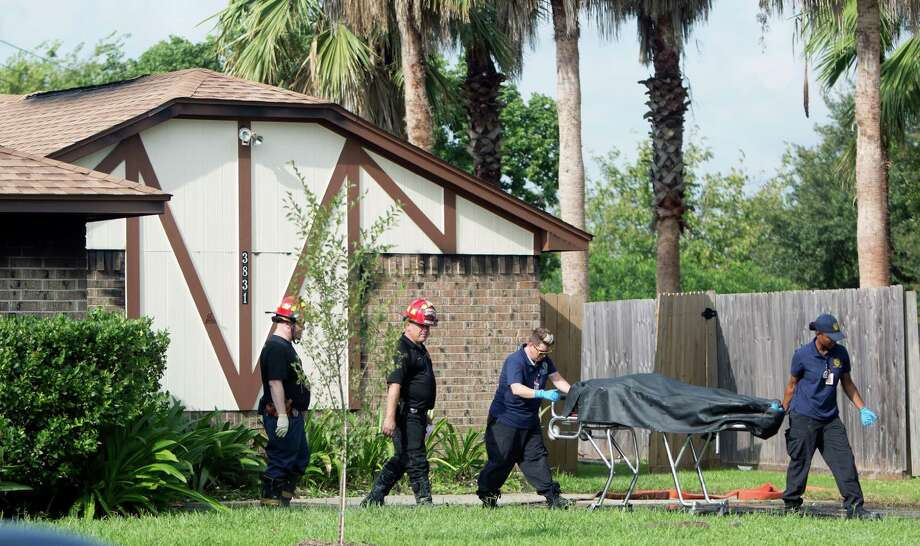 Authorities investigate the fatal fire in the 3800 block of Teakwood near Pecan in La Porte. No cause for the fatal blaze has been determined. A neighbor said the family had been in the house less than a year. Photo: Cody Duty, Staff / © 2015 Houston Chronicle
