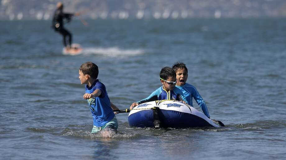 Zander Hauss, 9, Kevin Lau, 6 and Michael Tom, 8, beat the heat on the San Francisco Bay waters at Crissy Field on Tues. September 9, 2015,  in San Francisco, Calif., as temperatures soar throughout the Bay Area with more expected heat over the next few days. Photo: Michael Macor, The Chronicle