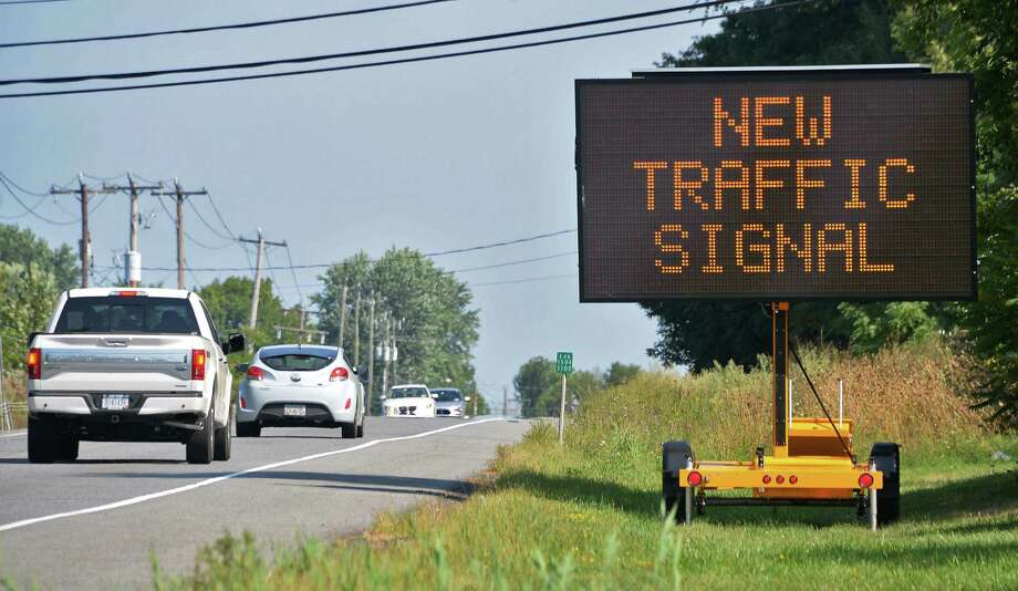 A traffic signs alerts motorist to a new traffic signal at Vosburgh Road and Covington Drive Wednesday Sept. 9, 2015 in Halfmoon, NY. Beginning tomorrow the new signal will add a blinking yellow arrow for left turns. The blinking arrow is meant to signify to motorists that they can legally make a left turn but must yield to other traffic.  (John Carl D'Annibale / Times Union) Photo: John Carl D'Annibale / 00033285A