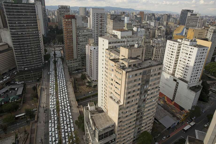 Taxi drivers block a street to protest Uber in downtown Sao Paulo this month. City leaders look as if they may ban the ride-hailing service. Photo: Andre Penner, Associated Press