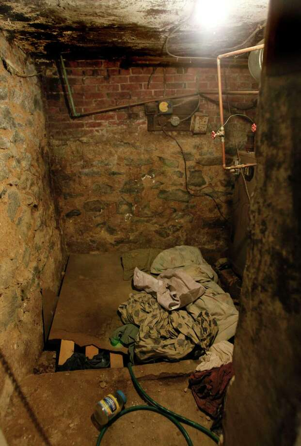 FILE - This Oct. 17, 2011 file photo shows the sub-basement room in Philadelphia where four weak and malnourished mentally disabled adults, one chained to the boiler, were found locked inside.  Linda Weston, accused of keeping mentally disabled adults captive in the basement for their disability checks has pleaded guilty, Wednesday, Sept. 9, 2015,  to all counts in a deal that will spare her a possible death sentence.  (Ron Cortes/The Philadelphia Inquirer via AP, Pool) Photo: Ron Cortes, POOL / Associated Press / Pool Philadelphia Inquirer