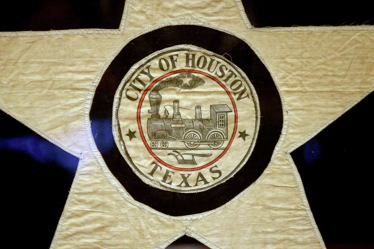 A 1915 prototype for the City of Houston flag at a press conference in the City Council Chambers of Houston City Hall Wednesday, Sept. 9, 2015, in Houston, Texas. Mayor Annise Parker, the City of Houston, Preservation Houston and the North American Vexillogical Association (NAVA) announced the restoration of the flag. The prototype was made by the seamstresses at Levy Bros. department store and then sent to New York where it served as the model for the official silk flag.