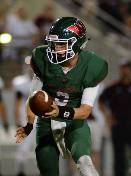 Junior quarterback Eric Schmid will have a lot to say as to whether The Woodlands can post a third victory over Katy within a seven-year span. Photo: Jerry Baker, Freelance