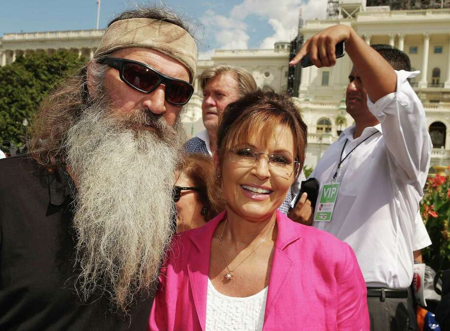 WASHINGTON, DC - SEPTEMBER 09:  Reality television personality Phil Robertson (L) and Sarah Palin pose for photographs during a rally against the Iran nuclear deal on the West Lawn of the U.S. Capitol September 9, 2015 in Washington, D.C. Thousands of people gathered for the rally, organized by the Tea Party Patriots, which featured conservative pundits and politicians.  (Photo by Chip Somodevilla/Getty Images) Photo: Chip Somodevilla, Staff / 2015 Getty Images