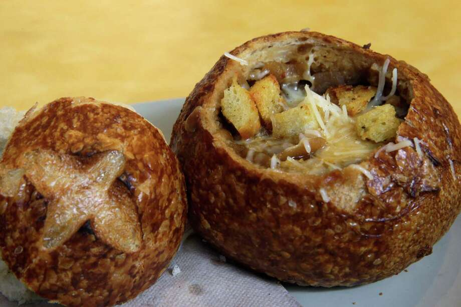 FILE - This June 9, 2015, file photo, shows a Bistro French Onion Soup Bread Bowl at a Panera bread restaurant in New York. The city Board of Health voted unanimously Wednesday, Sept. 9 to require chain eateries to put salt-shaker symbols on menus to denote dishes with more than the recommended daily limit of 2,300 milligrams of sodium. A Bistro French Onion Soup Bread Bowl contains more sodium than the recommended daily limit, which is equal to about 1 teaspoon of salt. (AP Photo/Mary Altaffer, File) ORG XMIT: NY117 Photo: Mary Altaffer / AP