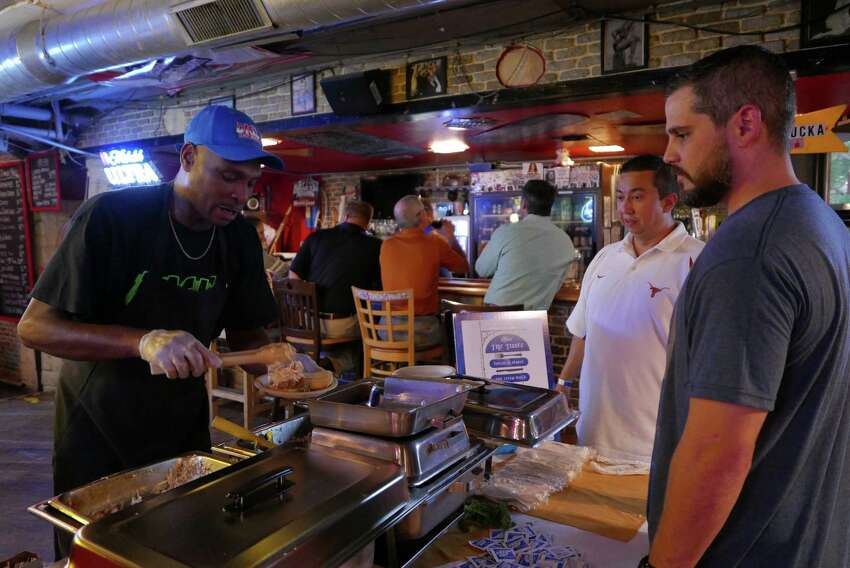 Edward Davis serves pulled Pork Sliders at Dick's Last Resort during day two of the three-day