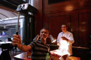 "Frank Flores takes a picture of himself with executive chef James Bocanegra, who served ""Mac 'N Cheese with Jalapeno Bacon,"" at Rivers Edge restaurant in the Hilton Palacio del Rio during day two of the three-day ""The Taste"" event on the  River Walk on Wednesday, Sept. 9, 2015. The event is providing over 30 restaurants a showcase for their culinary prowess by serving appetizer-sized portions of signature dishes from their menus. Tuesday featured only restaurants located on Houston Street in downtown San Antonio. Day three on Thursday is also dedicated to River Walk restaurants."
