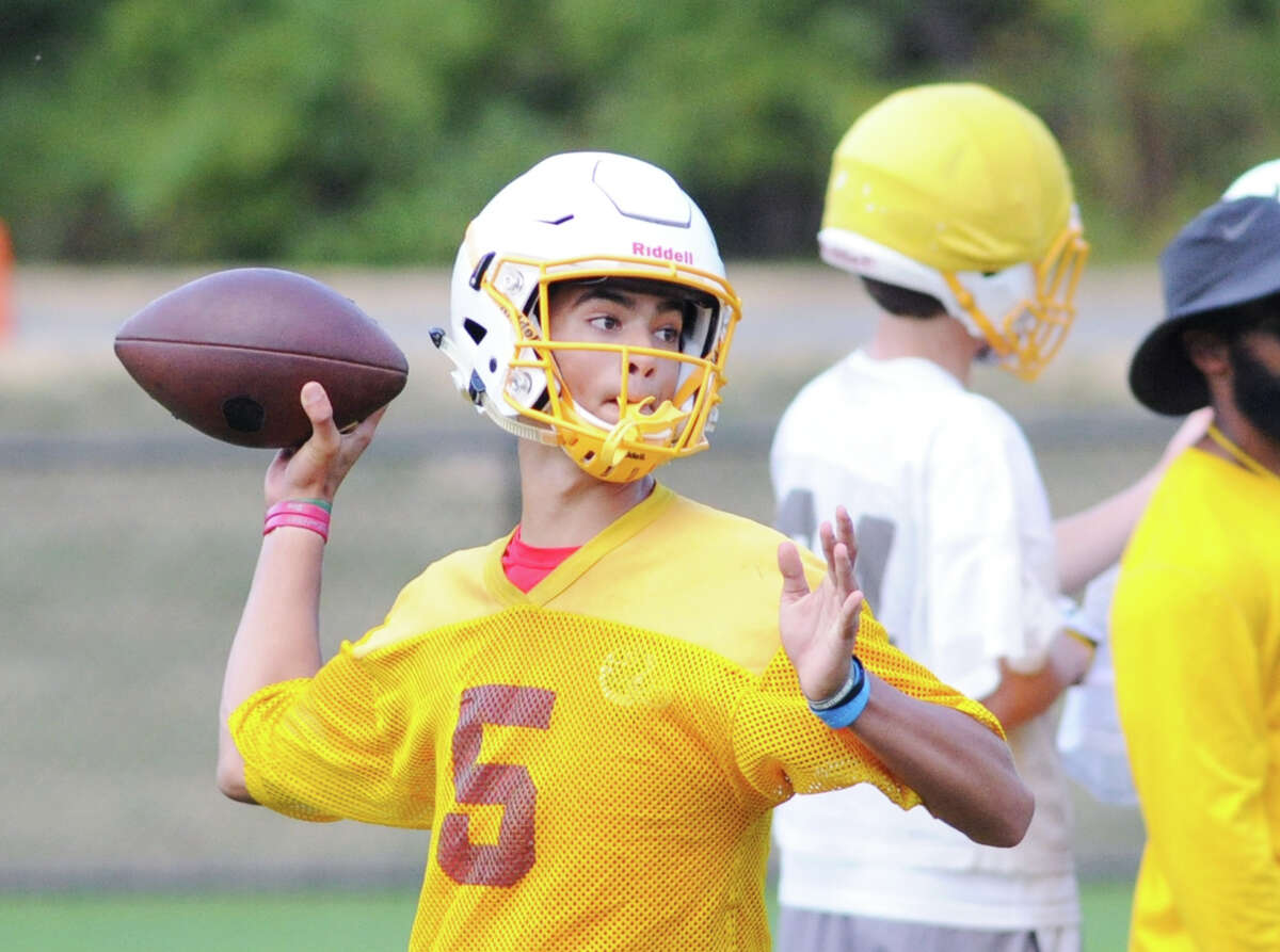 Brunswick School quarterback Nick Henkel (#5) throws during football practice at the school in Greenwich, Conn., Wednesday, Sept. 9, 2015.