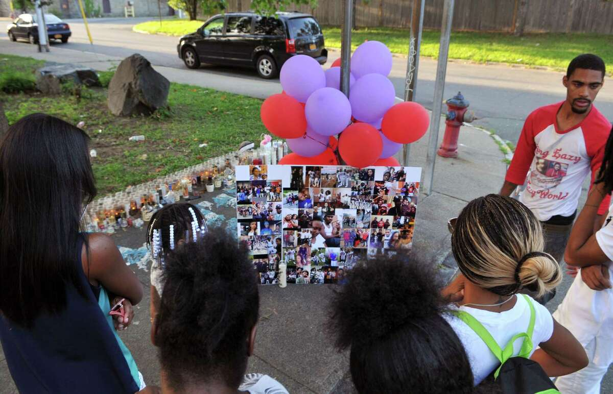 Troy residents look on at Ahziarh Carter's memorial during an anti-violence rally to protest this year's second deadly shooting in Troy on Thursday, Aug 20, 2015, in Troy, N.Y (Phoebe Sheehan/Special to The Times Union) ORG XMIT: MER2015082019570529