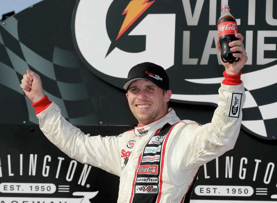 Denny Hamlin celebrates in victory lane after winning a NASCAR Xfinity auto race at Darlington Raceway in Darlington, S.C., Saturday, Sept. 5, 2015. (AP Photo/Terry Renna) ORG XMIT: SCTR107 Photo: Terry Renna / FR60642 AP