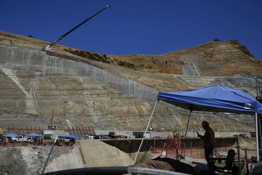 A construction worker finds some shade while working on the Calaveras Dam replacement project near Fremont on Aug. 12. The SFPUC is replacing the dam to meet new zoning requirements for earthquakes along the Calaveras Fault. Photo: Leah Millis, The Chronicle